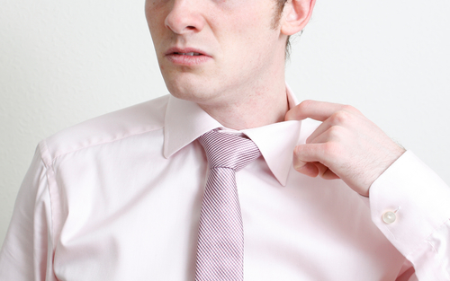 man is hot under the collar before job interview