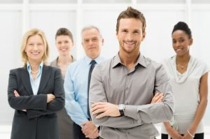 Q&A Portrait Of Young Businessman With Business Team