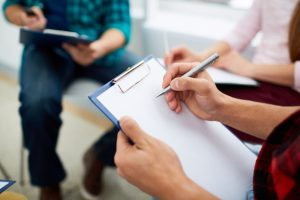 Career Psychologist making notes on paper sheet
