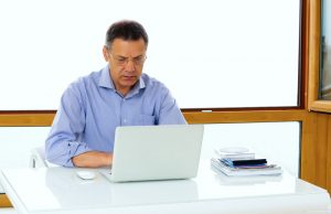 mature man working and learning on his laptop computer
