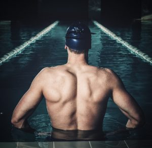 male swimmer in his lane (respecting workplace boundaries)