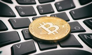 Blockchain is the technology of bitcoin (coin on keyboard)
