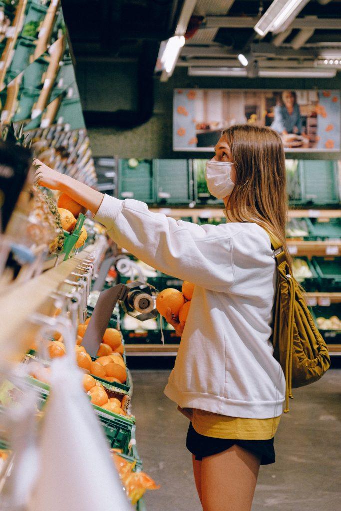 woman shopping despite pandemic grief