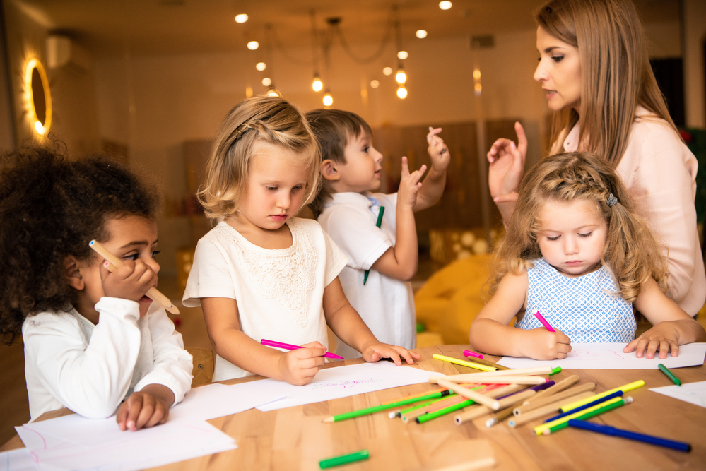 group of kids with tutor