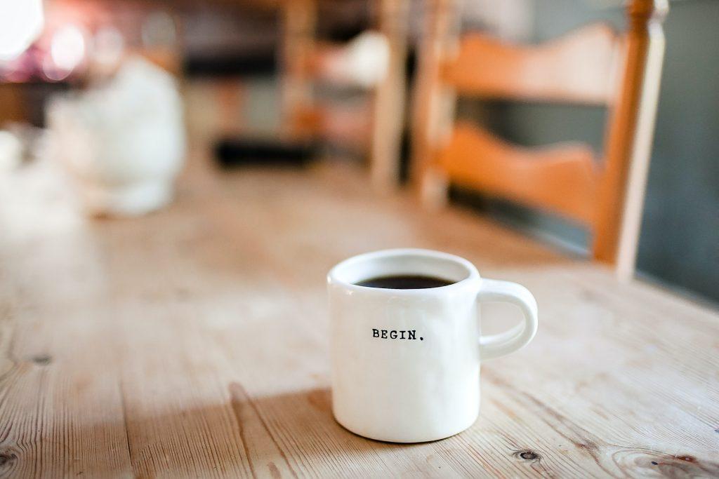 white mug that says begin