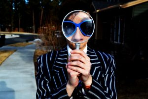 looking carefully - through magnifying glass