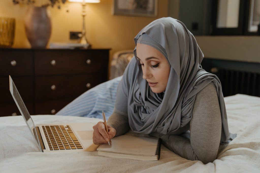 Muslim woman working at home